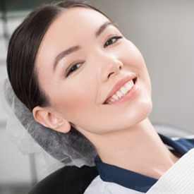 smiling woman lying in the dental treatment chair