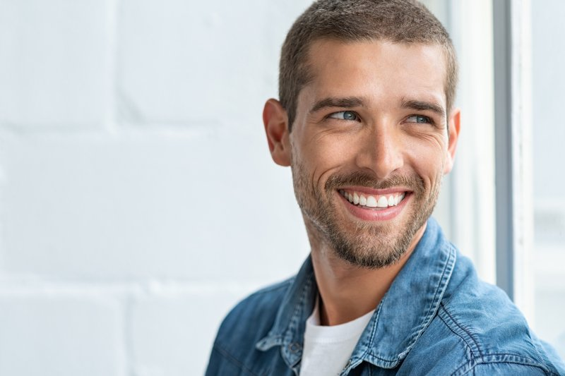 man smiling and looking away