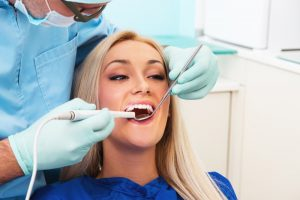 blonde woman, woman smiling, dental visit, cosmetic dentistry