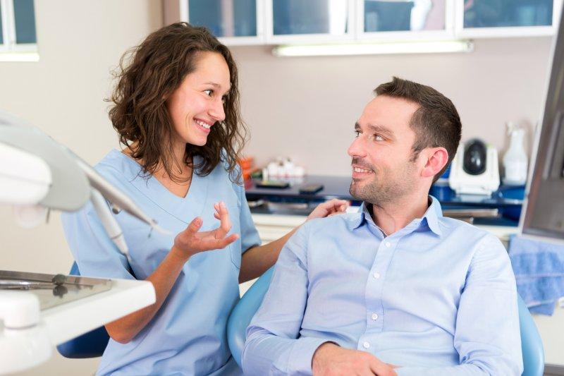 Dentist explaining dental savings plan in Waco to patient