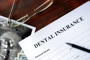 Dental insurance paperwork on a desk.