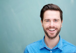 young man smiling with teeth fully restored thanks to Waco CEREC