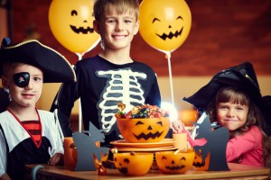 kids smiling with halloween candy ready to visit the family dentist waco loves